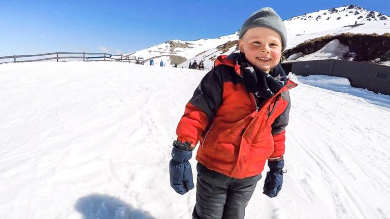 Nathan from Backyard Travel Family smiles after he completes his first run on the beginners slop at Mt Hutt Skifield, Canterbury, New Zealand