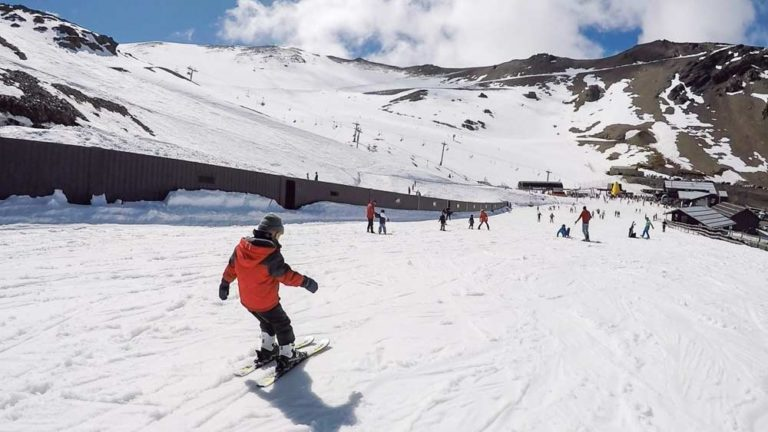 4 year skiis downhill on the beginner slope, learning to ski at Mt Hutt Skifield, Methven, Canterbury, New Zealand // Backyard Travel Family