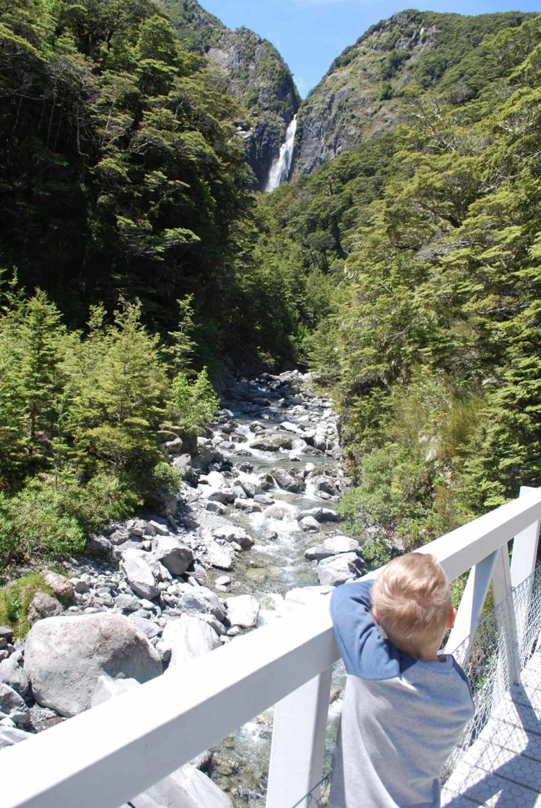 View from the bridge of Devils Punchbowl Falls, off in the distance, Canterbury, New Zealand I Photo by Backyard Travel Family
