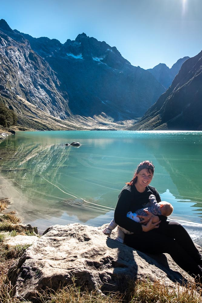 See this beautiful alpine lake on Lake Marian track, a great half way walk on the Milford Road Highway, Fiordland. You can even walk to Lake Marian with kids by Backyard Travel Family