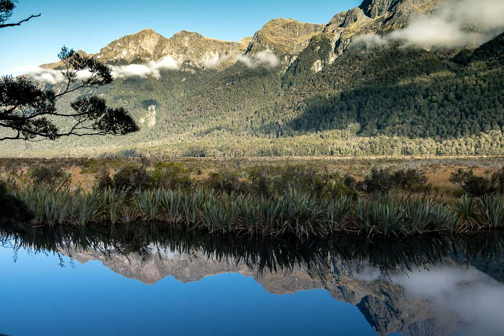 Beautiful reflections at Mirror Lakes, Fiordland, on the Milford Sound Road, by Backyard Travel Family