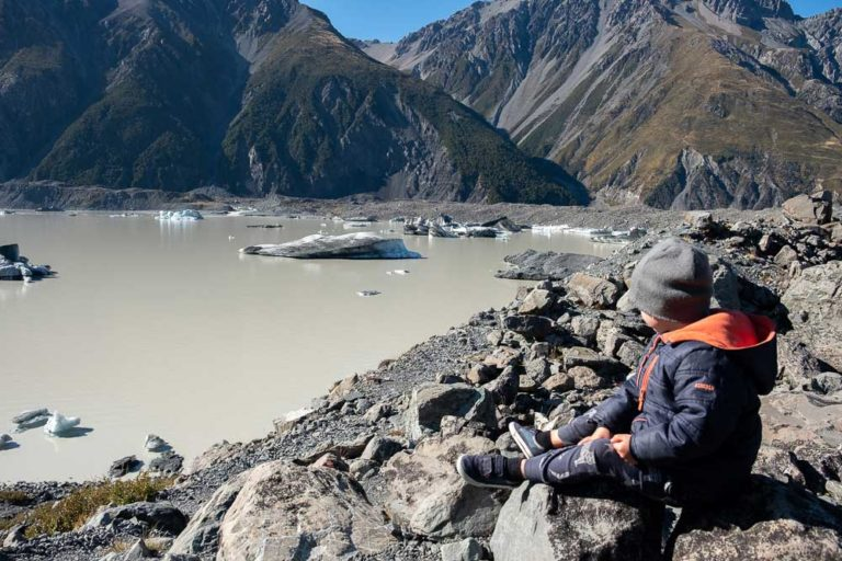 Kipton from Backyard Travel Family check out the icebergs at the Tasman Lake, on the Tasman Glacier Lake Walk, Short walk in Mt Cook National Park, perfect family walk with kids