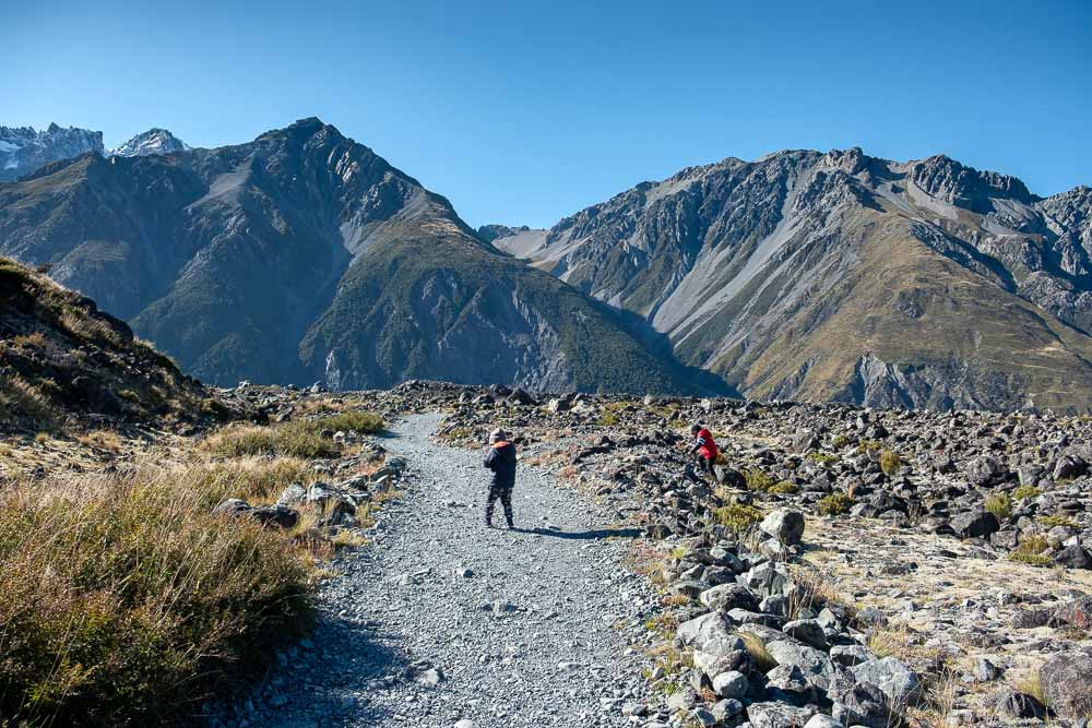 Kipton and Nathan from Backyard Travel Family check out the trail, on the Tasman Glacier Lake Walk, Short walk in Mt Cook National Park, perfect family walk with kids