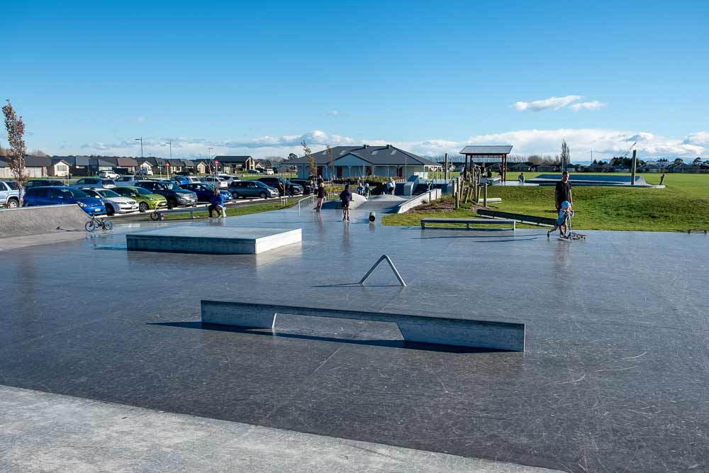 View over the scooter surface with jumps and rails, perfect for scootering, skateboarding and biking at Knights Stream Park, Halswell, Christchurch, New Zealand