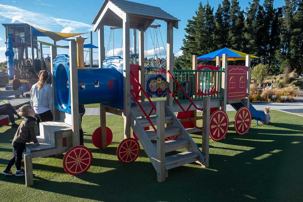 Nathan from Backyard Travel Family explores the train at the best playground in Canterbury, Foster Park Playground