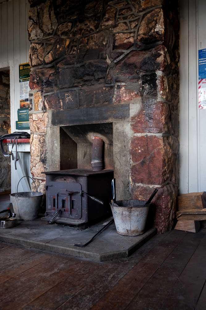 Old warm fire inside Packhorse Hut. You can stay here overnight in the bunk room, or stop here on a half day hike. It's nice and warm inside Packhorse Hut