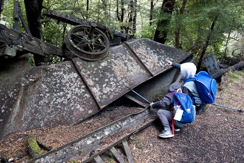 Nathan from Backyard Travel Family examines the old coal mining ruins on the Woolshed Creek Hut Walk, Mt Somers Track / A great half day walk for the family or beginners overnight hike