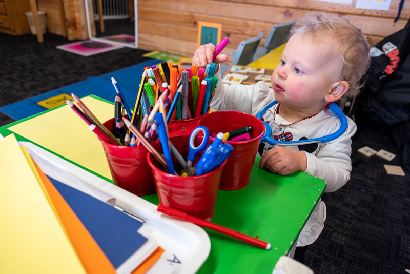 Emilia from Backyard Travel Family steals a pen from the art supplies inside Skiwland at Mt Hutt Skifield, near Christchurch, New Zealand