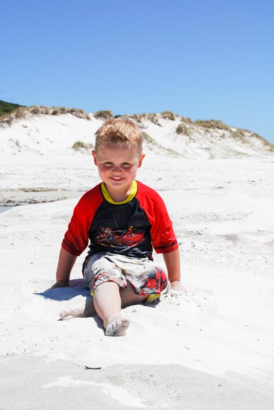Kipton from Backyard Travel Family delights in the bright white sand at Rarawa Beach in New Zealands far north