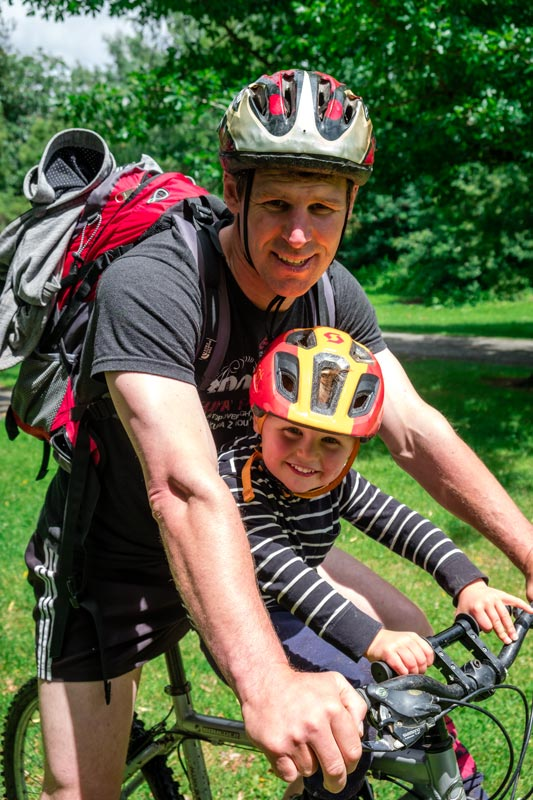 Kipton and Ashley from Backyard Travel Family finish their mountain bike ride in Hanmer Forest with smiles