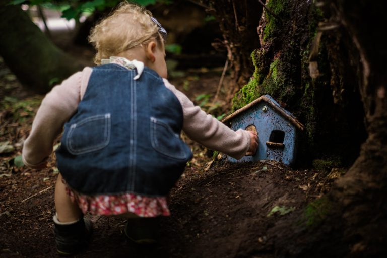 Emilia from Backyard Travel Faily inspects the fairy house on the Fairy Door Walk in Hanmer Springs