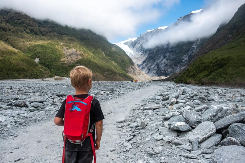 Young child walks the Franz Josef Glacier hike at 4 years old, an easy walk for kids in Franz Josef