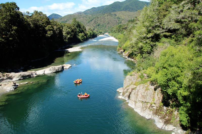 White Water Rafts float down the river in Murchison
