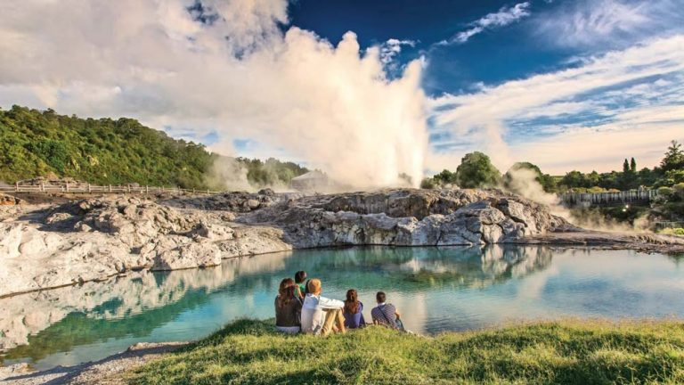 Family watch the steam and geyser at Te Puia Geothermal Valley in Rotorua