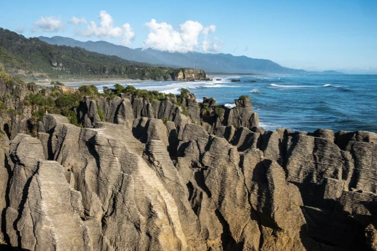The classic view of Pancake Rocks Punakaiki with the beautiful West Coast ocean in the background