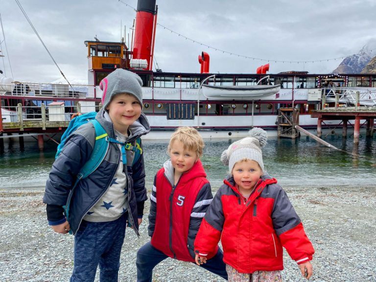 Backyard Travel Family in front of the TS Earnslaw steamboat in Lake Wakatipu, Queenstown