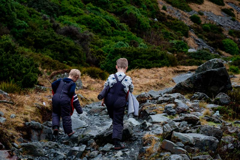 Nathan and Kipton from Backyard Travel Family hike up the short Kea Point Track to the viewpoint