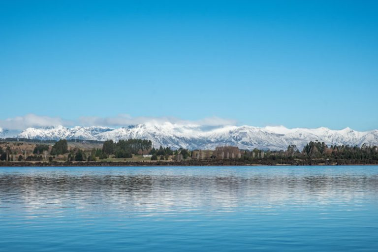Lake Te Anau with the snowy mountains in behind