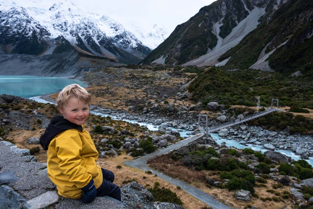 Kipton from Backyard Travel Family overlooks the first swing bridge at the start of the Hooker Valley Track
