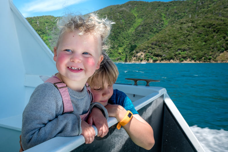 Kids smile while look at the view, on the Picton Mailboat