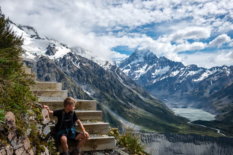 Nathan pauses on his Mt Cook hike up to the Sealy Tarns, Mount Cook, New Zealand