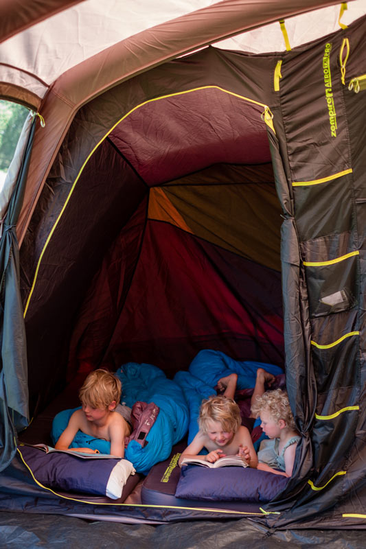 Backyard Travel Family kids are ready for bed in the Zempire tent bedroom, lying on their comfy monstamat sleeping pads, NZ