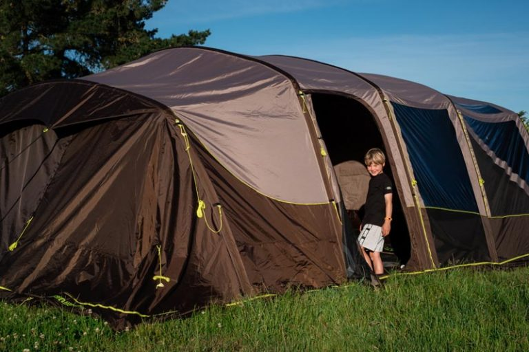 Nathan from Backyard Travel Family walks into his Zempire Aero TXL Pro tent in the camping ground, NZ