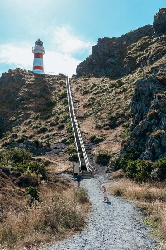 View of the Cape Palliser Lighthouse from the bottom of the stairs. Good walk near the Puntagirua Pinnacles