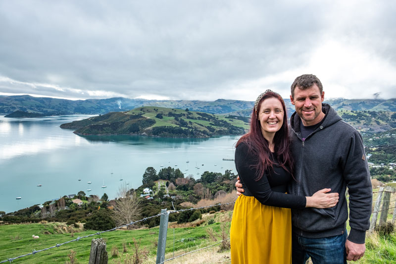 Ashley and Jen from Backyard Travel Family with the view of Akaroa Harbour in behind them