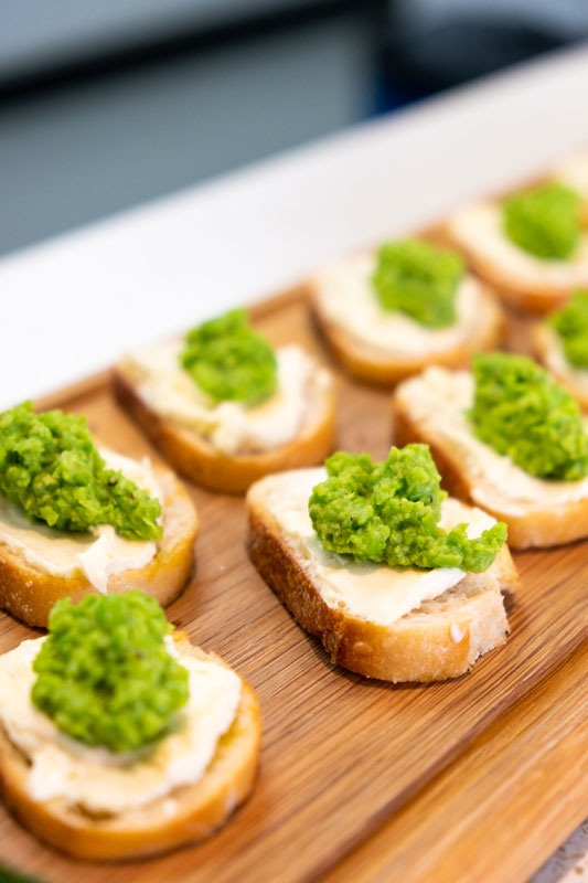 Pea puree and cream cheese on crostini, all prepared by the Akaroa Cooking School