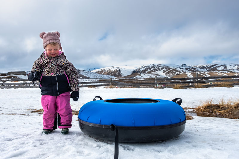 Emilia laughs after getting off her snow tube at Snow Farm Wanaka NZ