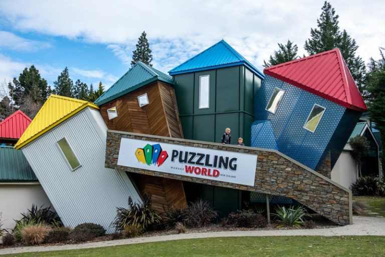 Boys stand in front on the wonky buildings at Puzzling World Wanaka New Zealand