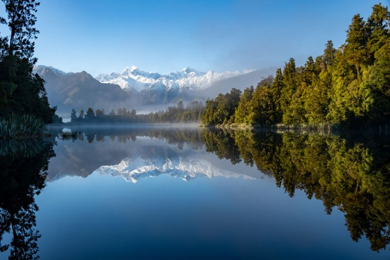 Sunrise at Lake Matheson with a beautiful reflection of Mt Cook and Mt Tasman