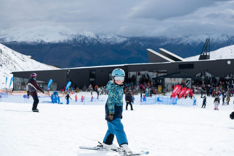 Nathan finishes skiing in Queenstown in front of the Remarkables