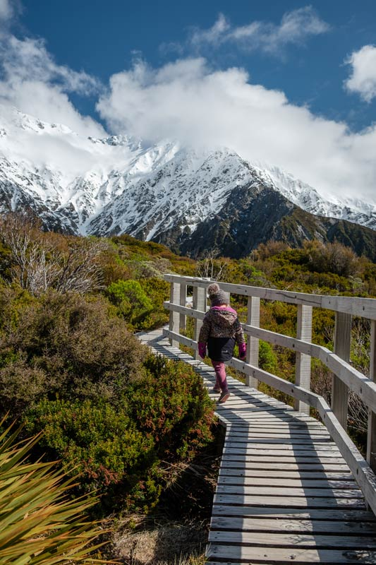 Emilia from Backyard Travel Family walks along the boardwalk path on the Red Tarns Track in Mt Cook National Park
