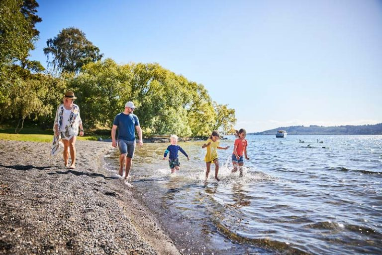 A family of 5 walk and swim in Lake Taupo NZ