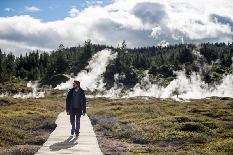 A man walks on the board walk at the Craters of the Moon walk in Taupo